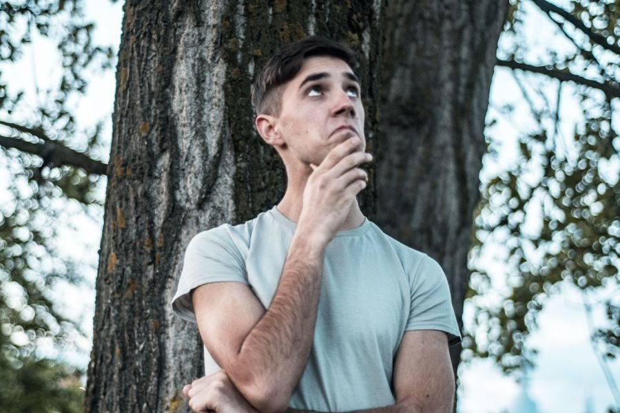 Young caucasian man walks in a park example image 1