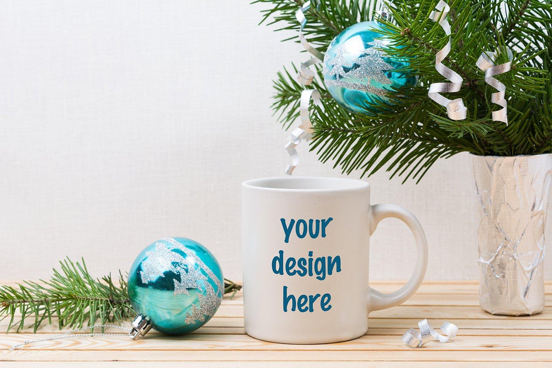 White coffee mug mockup with blue Christmas ornaments example image 1
