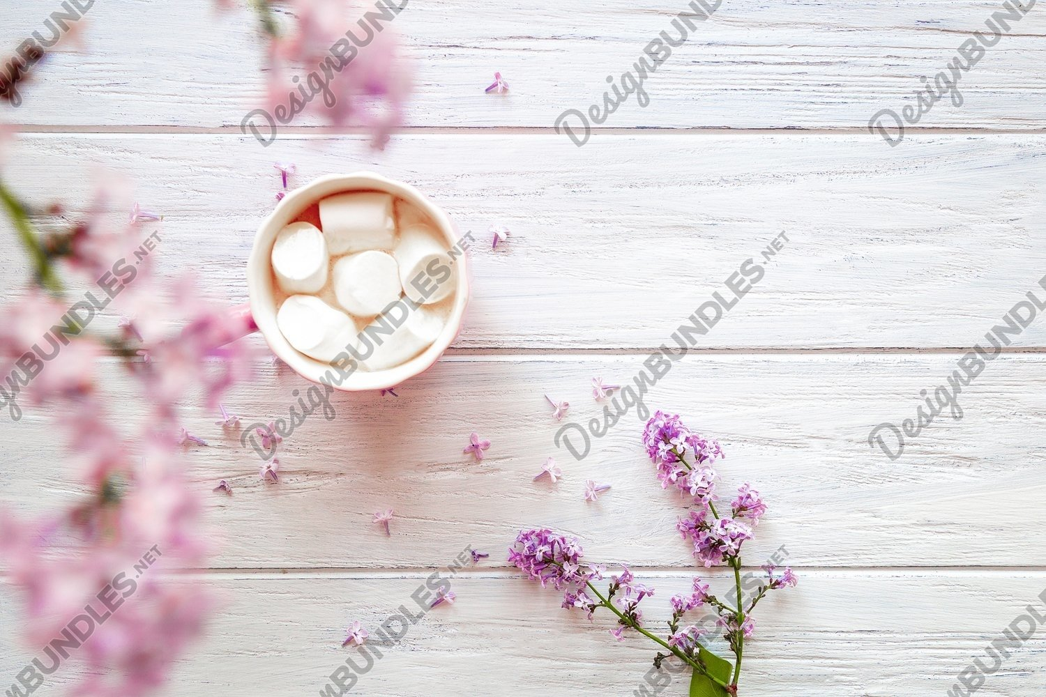 Photo of lilac and cups with sweets on a light background example image 1