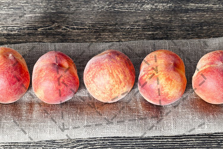row ripe orange peaches example image 1