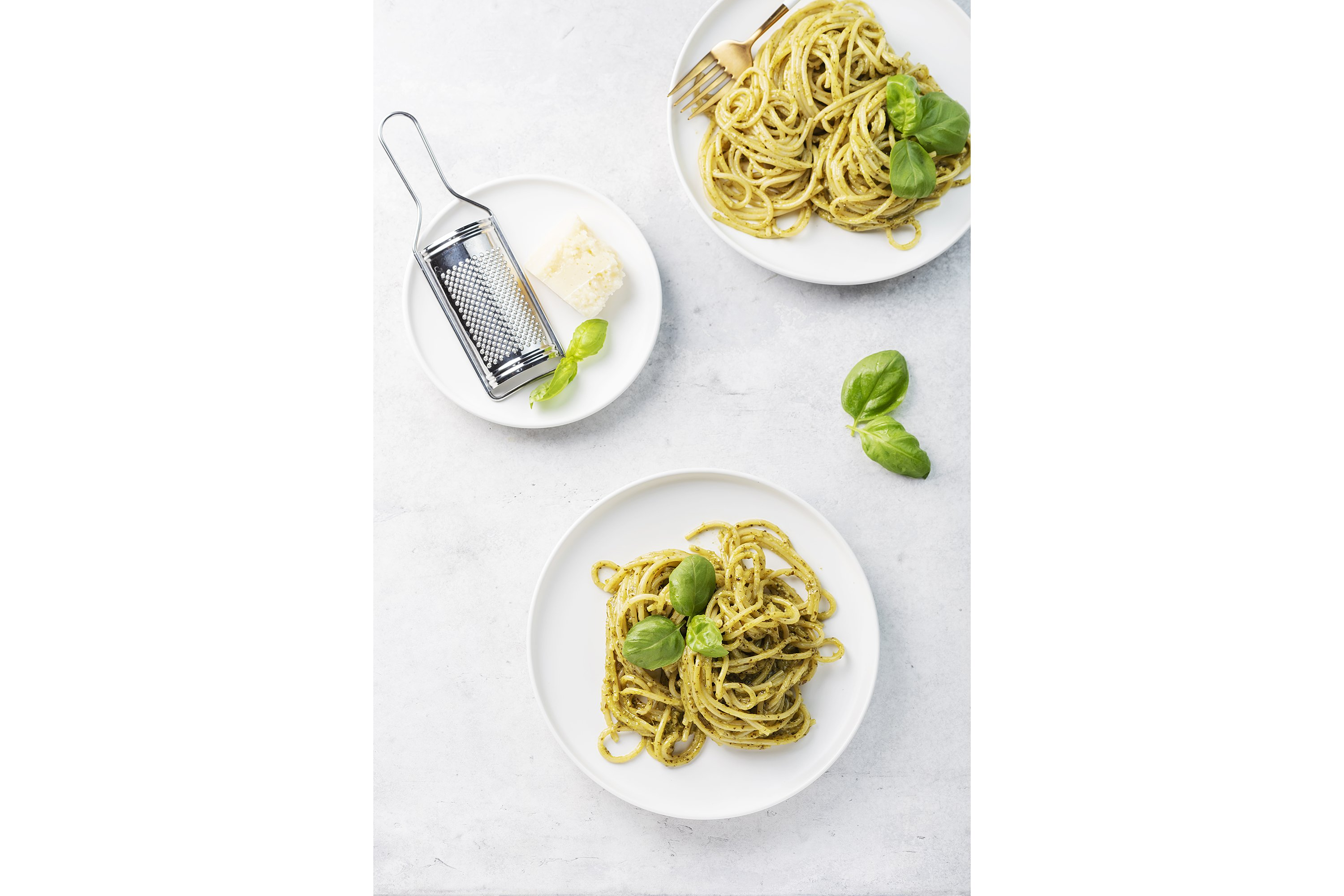 Italian spaghetti with pesto sause and parmesan cheese example image 1