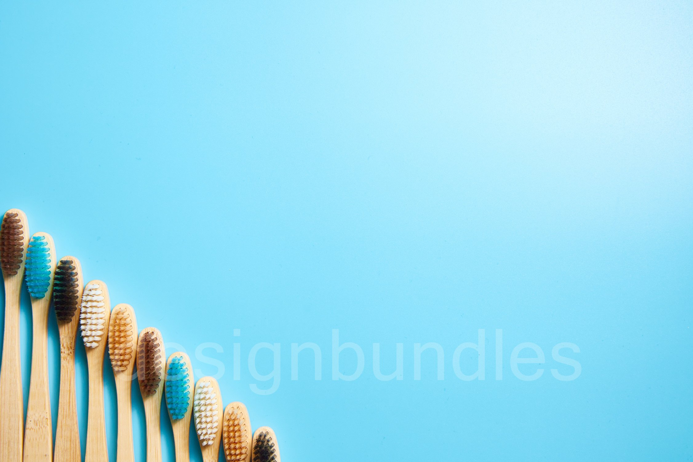 Multi-colored wooden toothbrushes. Place for text example image 1