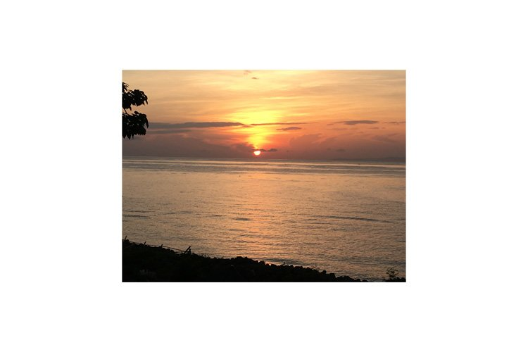 Photo of the sunset in the coastal town of Bacong example image 1