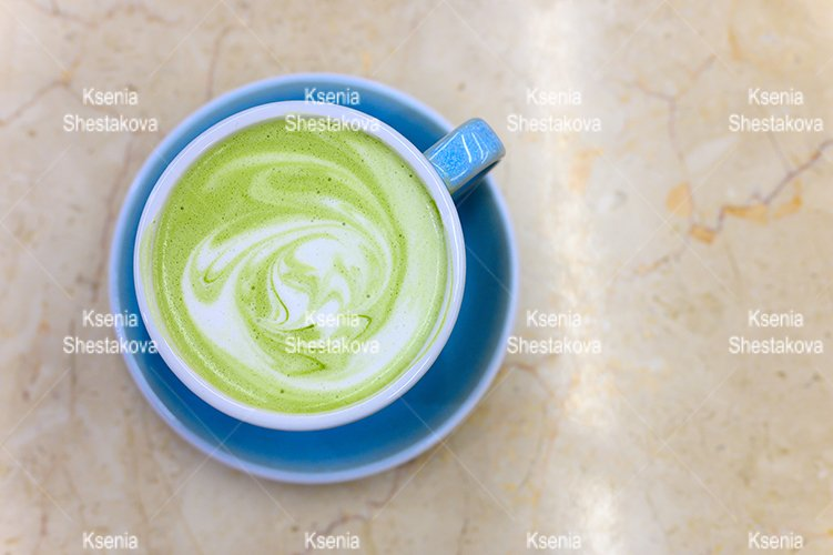 matcha green tea cup latte with a pattern of milk foam example image 1