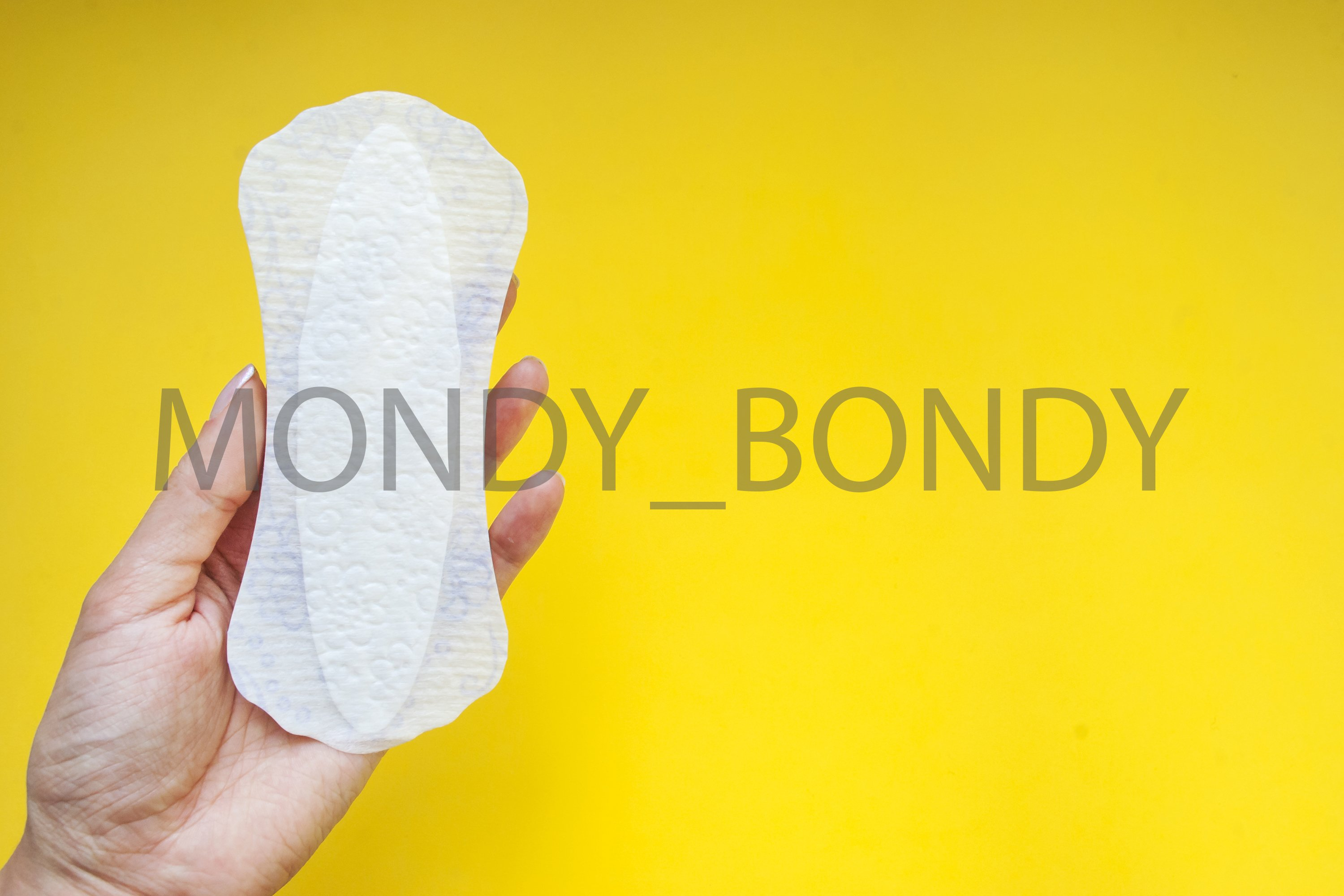 Women's daily laying on a yellow background. Menstruation. example image 1
