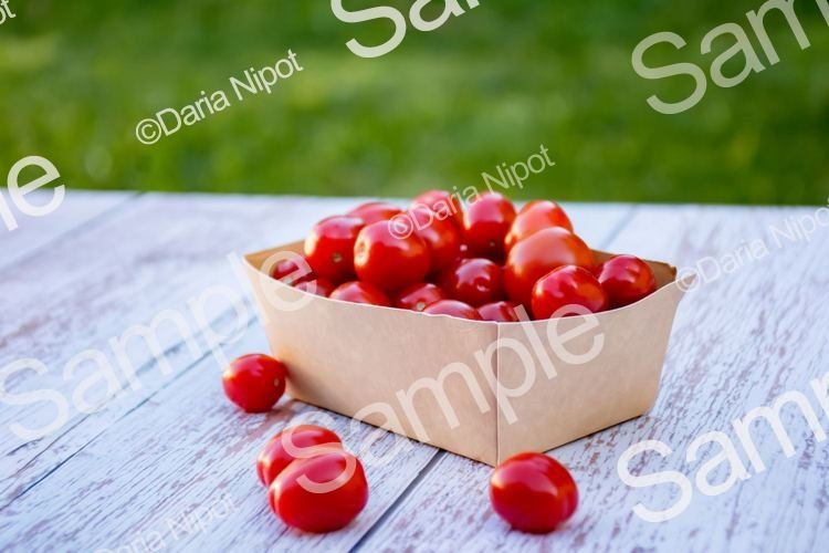 Cherry tomatoes in a recycleable paper box example image 1