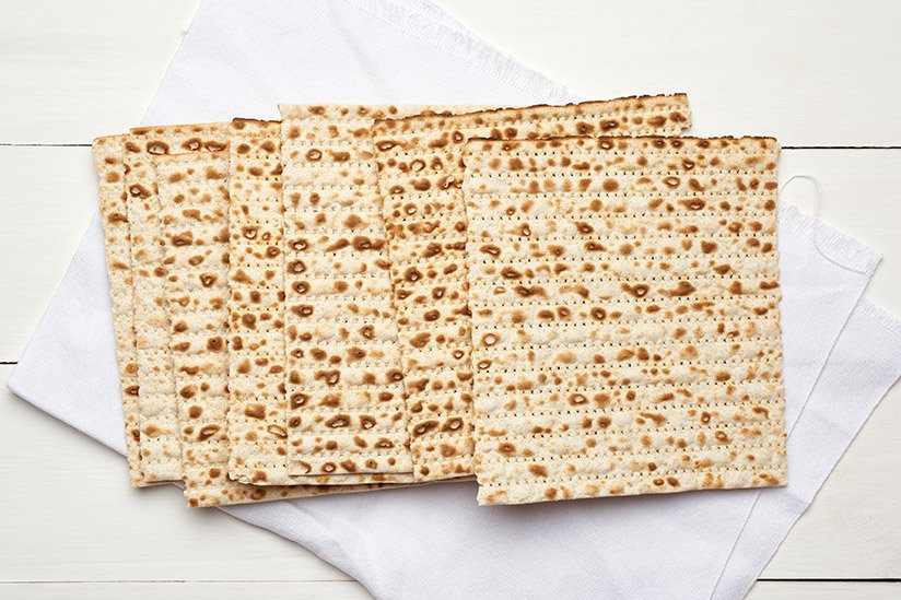 stack of baked square matzo on a white wooden background example image 2
