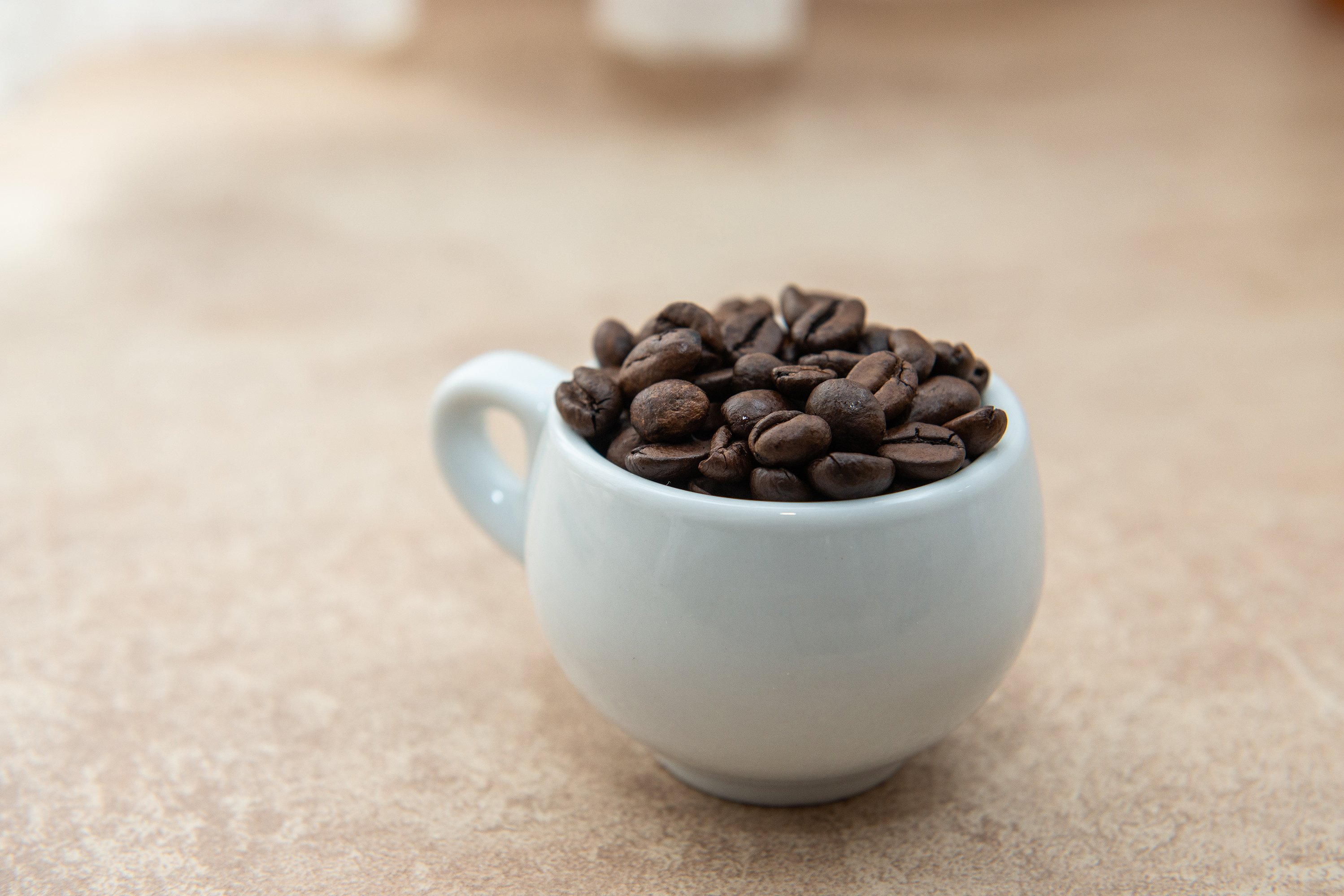 Cup of coffee full of coffee beans example image 1