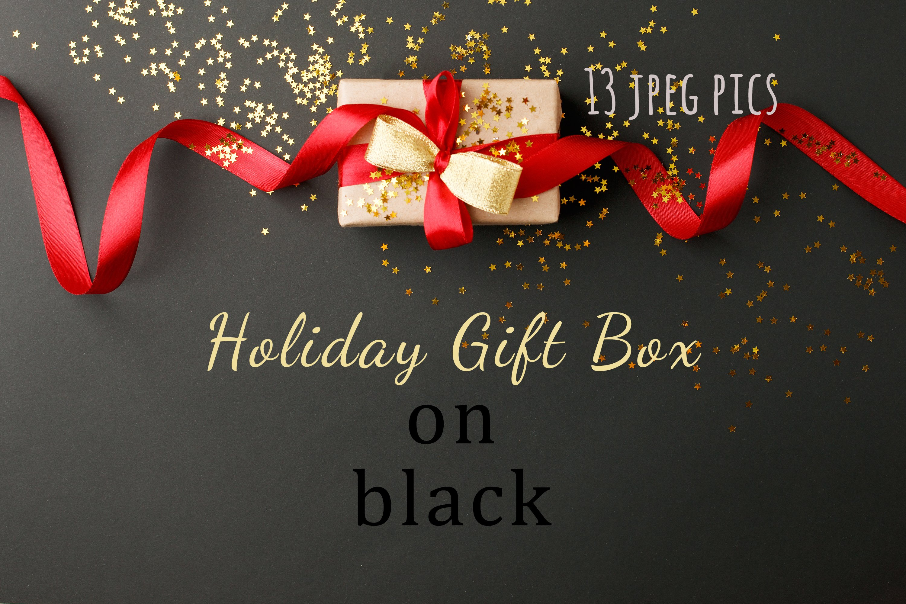 Gift box with bow and gold stars confetti on black table example image 1