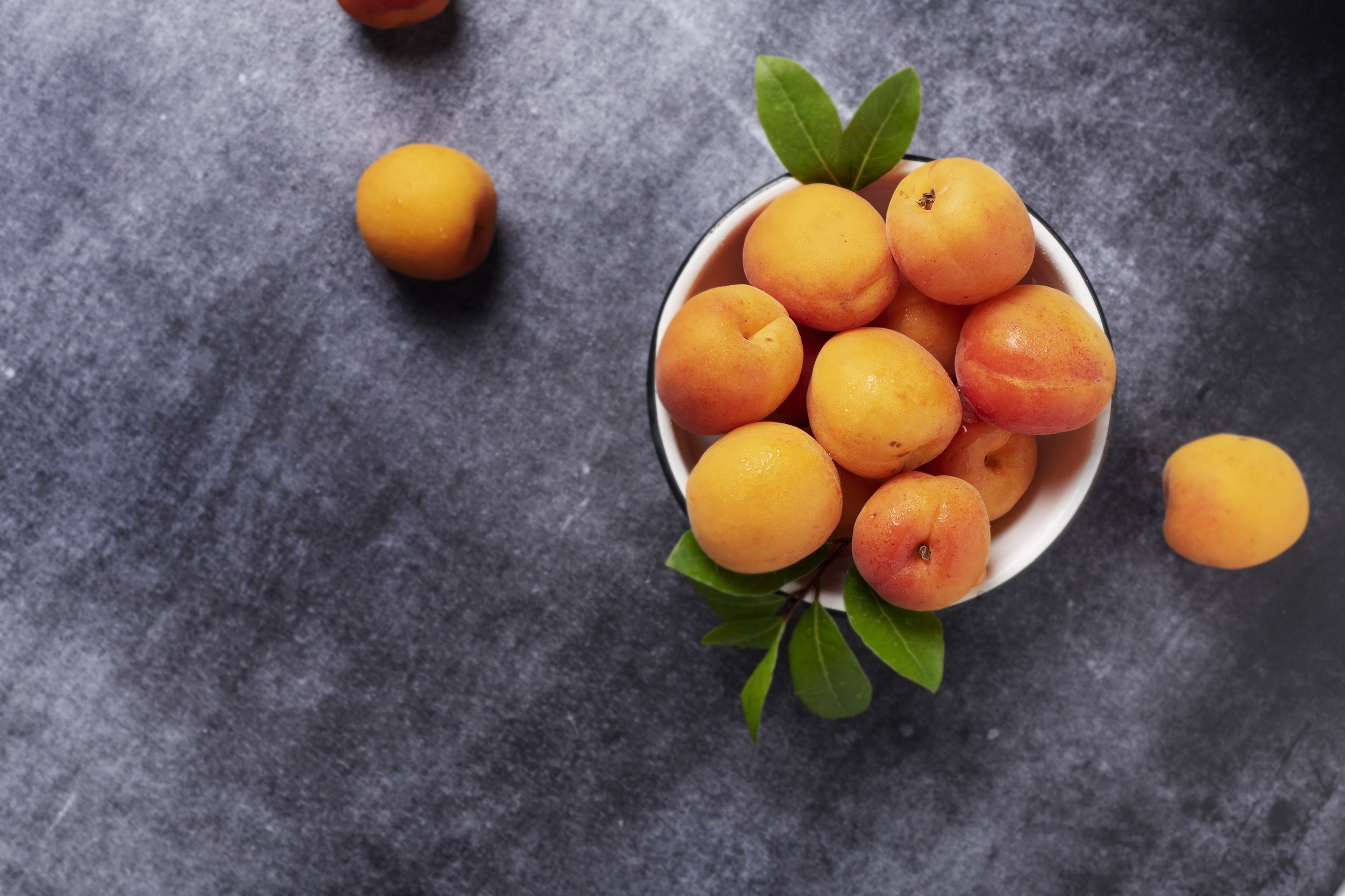 Sweet fresh apricots in the white bowl example image 1
