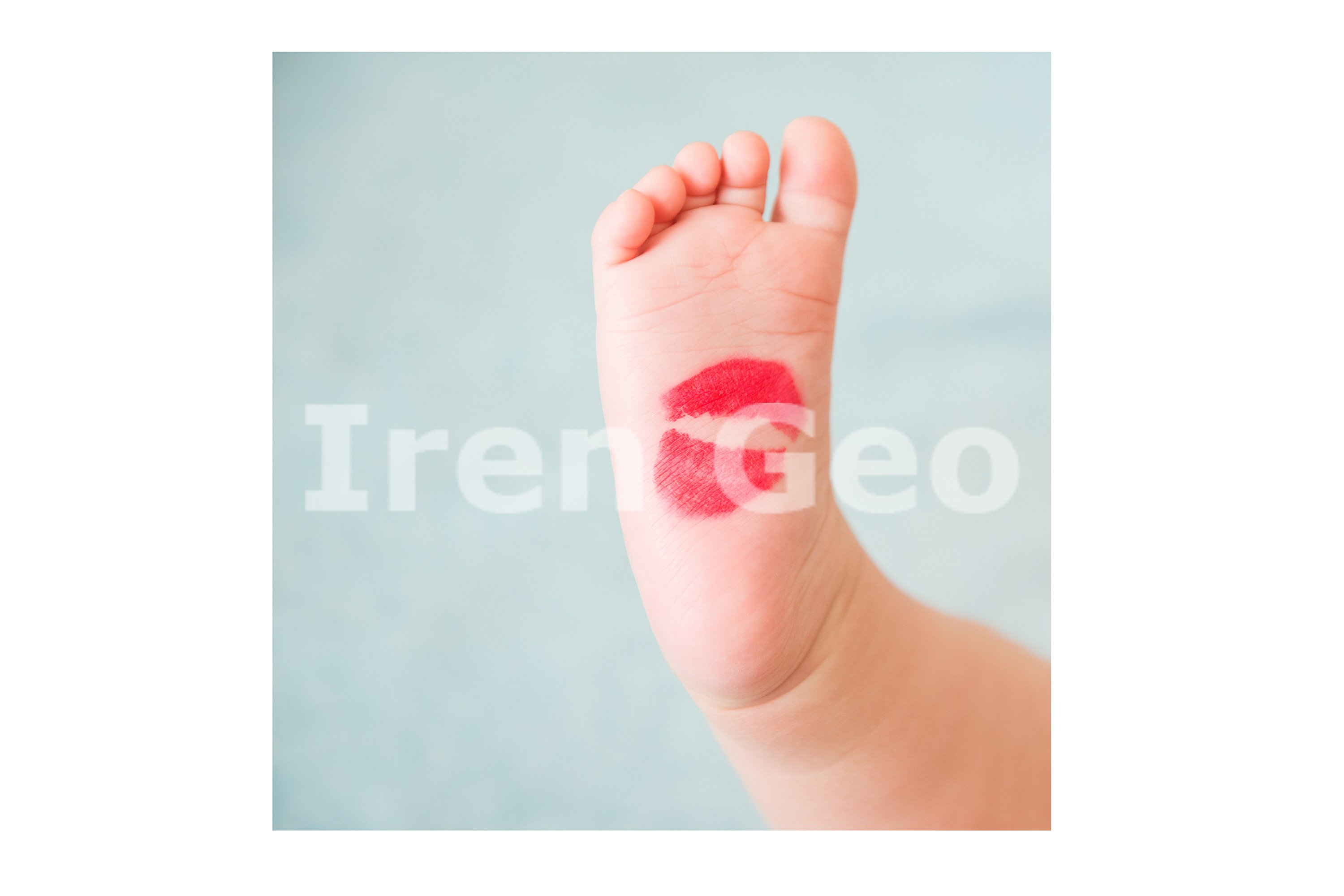 Baby's small foot with red lipstick from a kiss example image 1