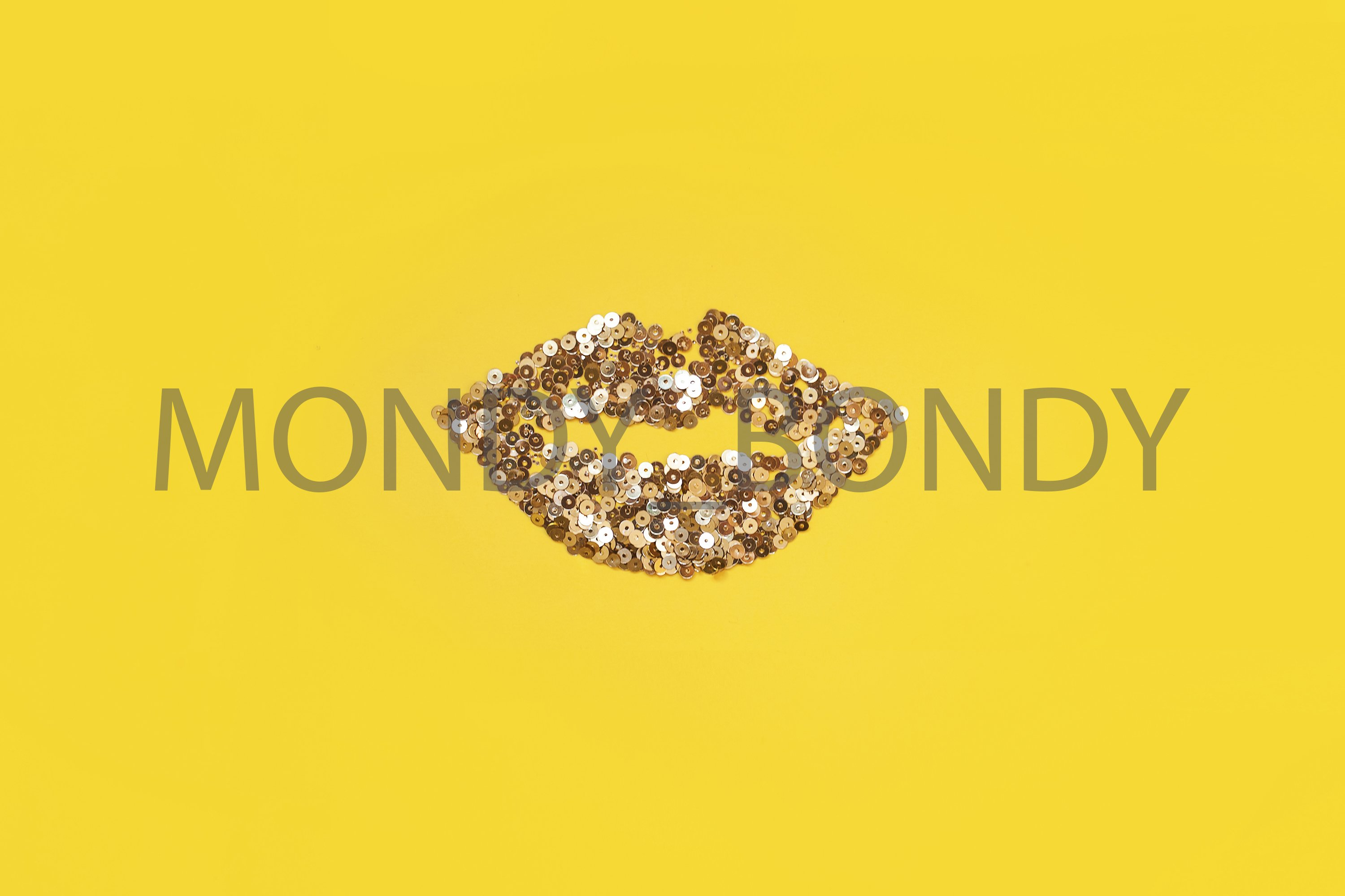 Lips from little golden confetti on a yellow background. example image 1