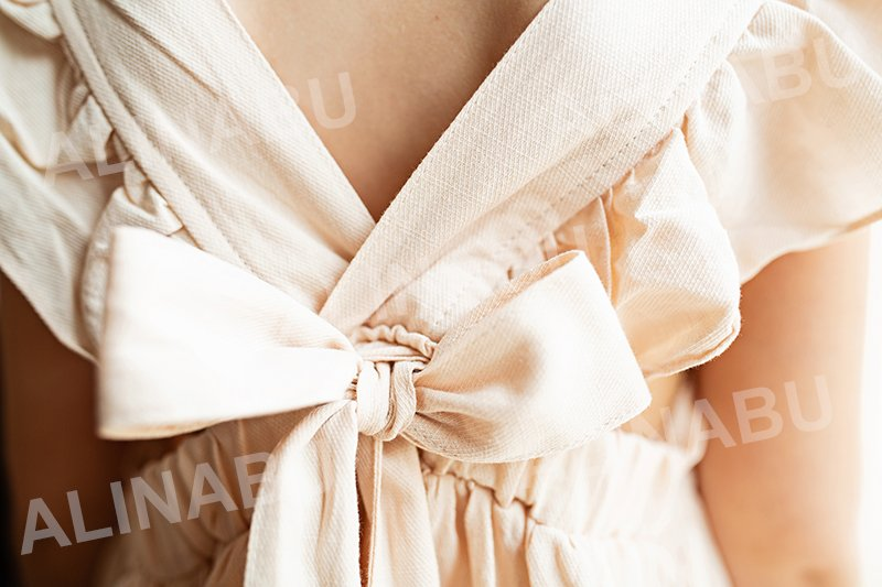 dress for a girl neutral beige color closeup example image 1