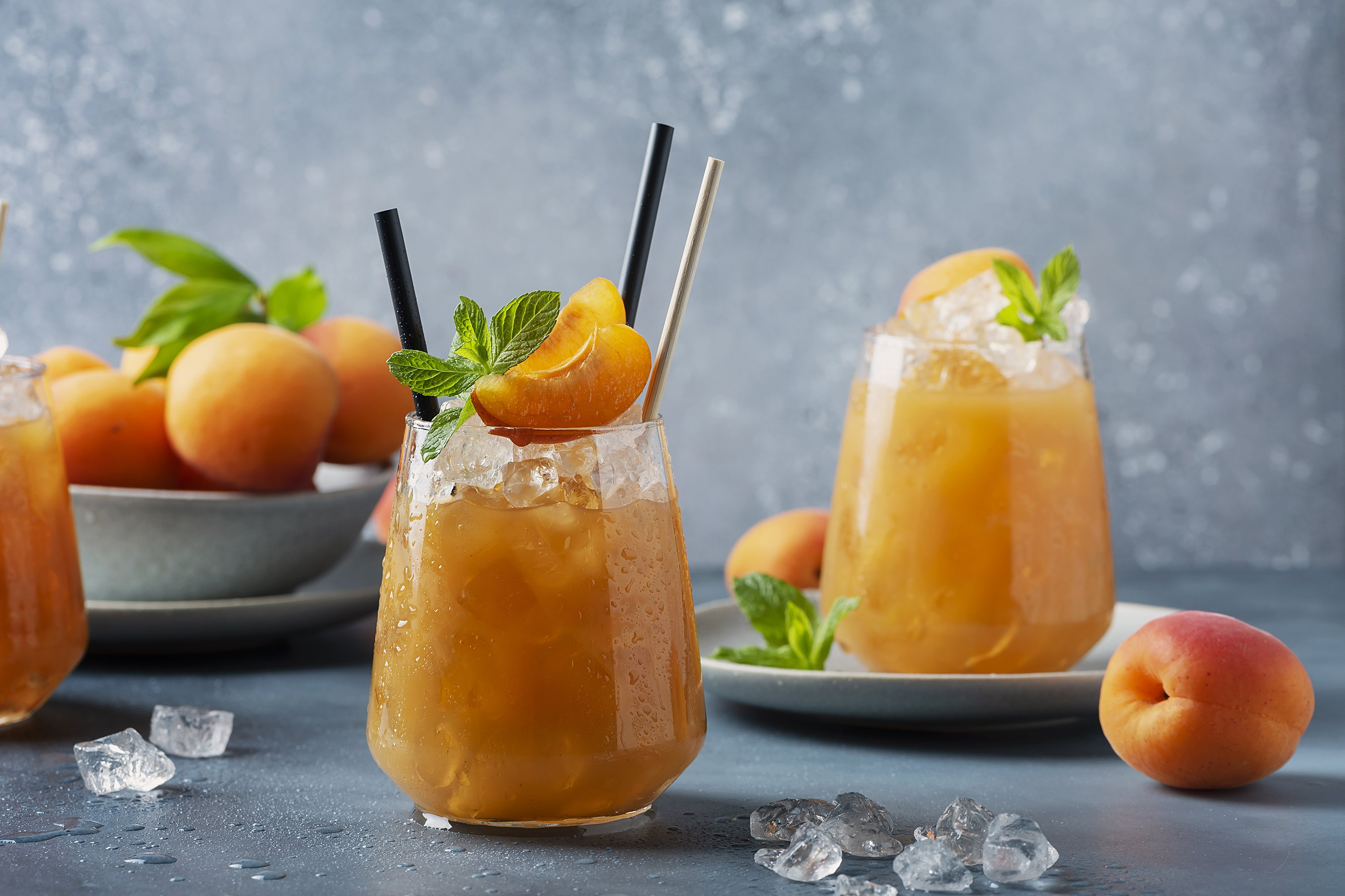 Fresh apricot cocktail with ice and mint example image 1