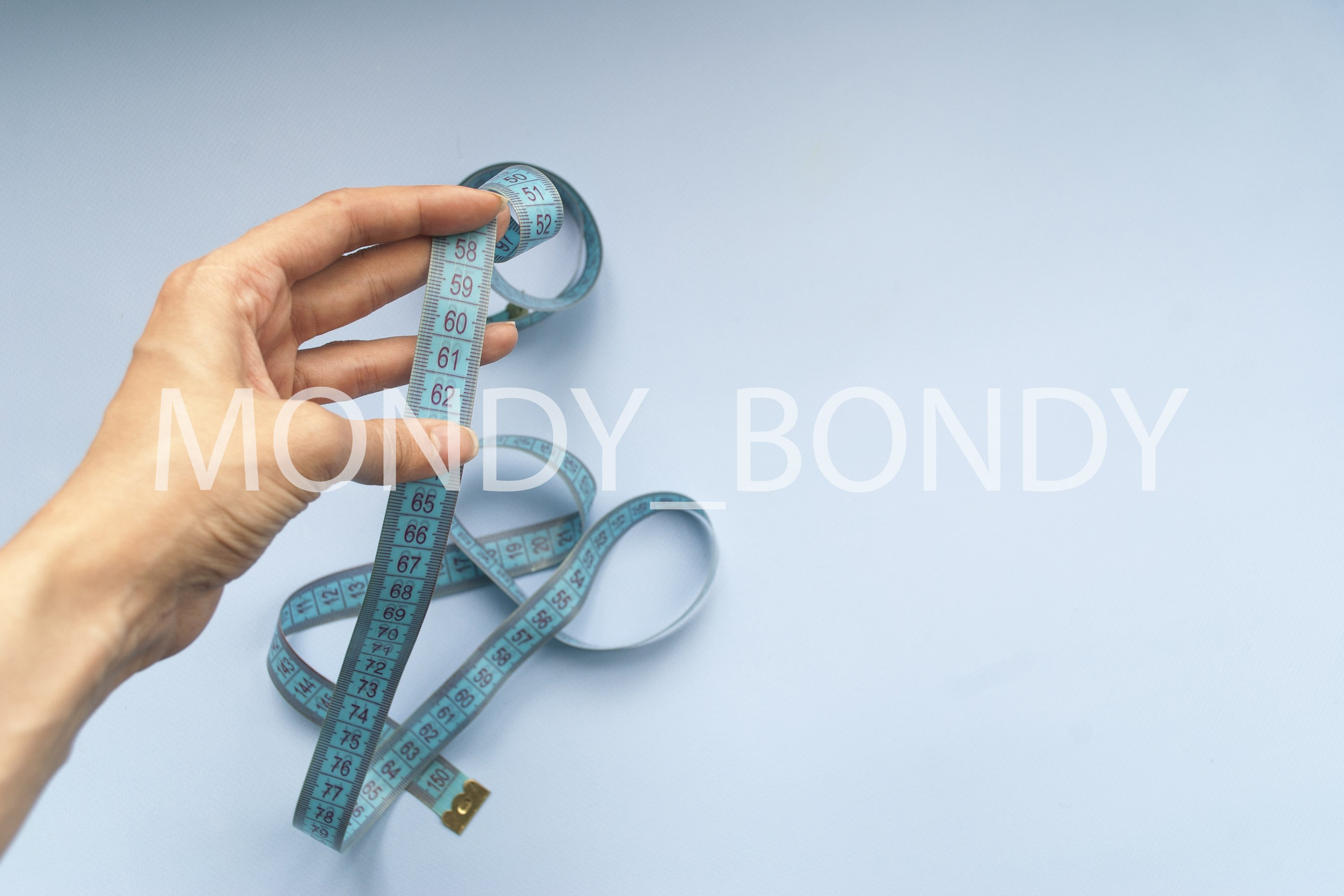 Blue centimeter for measuring body parameters. example image 1