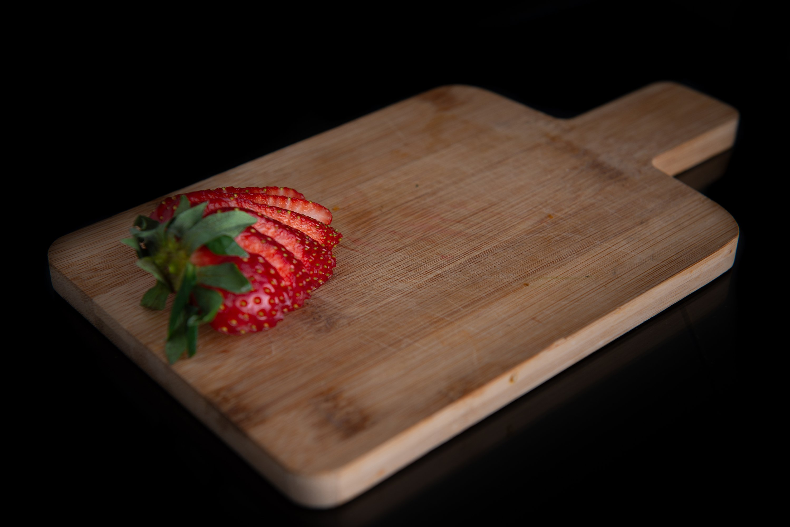 sliced strawberry on a wooden board with a place for text example image 1