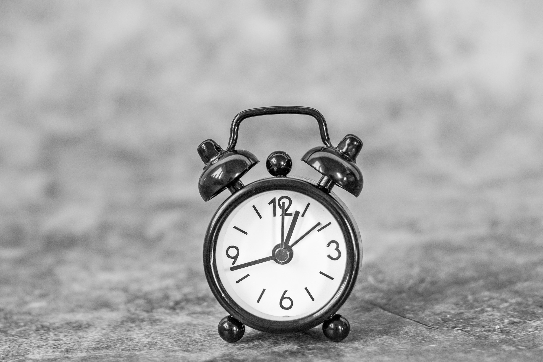 Black retro alarm clock on a vintage dark background example image 1