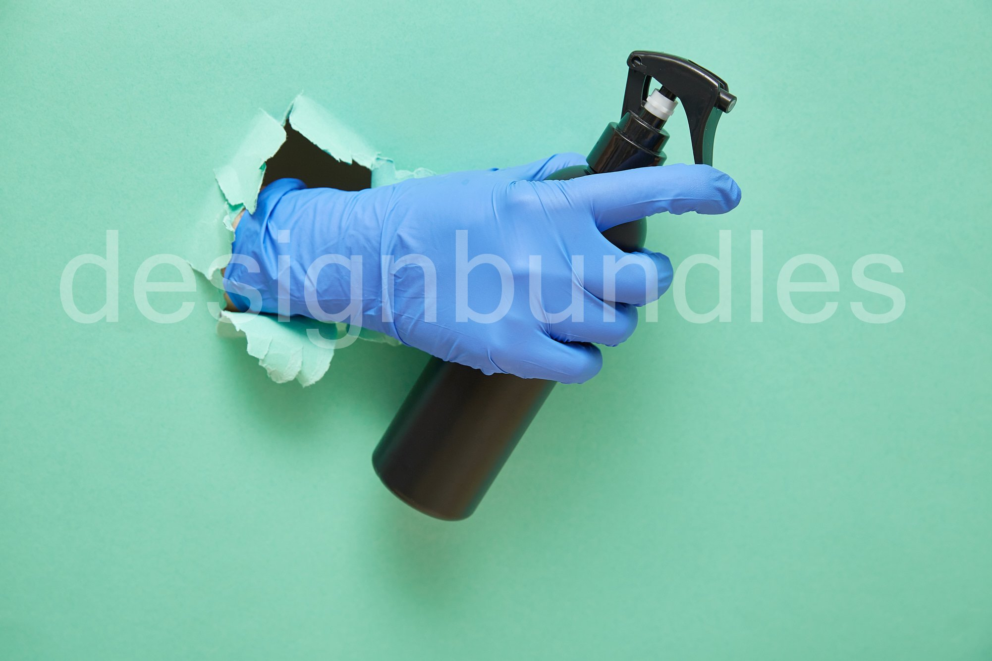 a gloved hand holds a disinfectant in a black spray bottle. example image 1