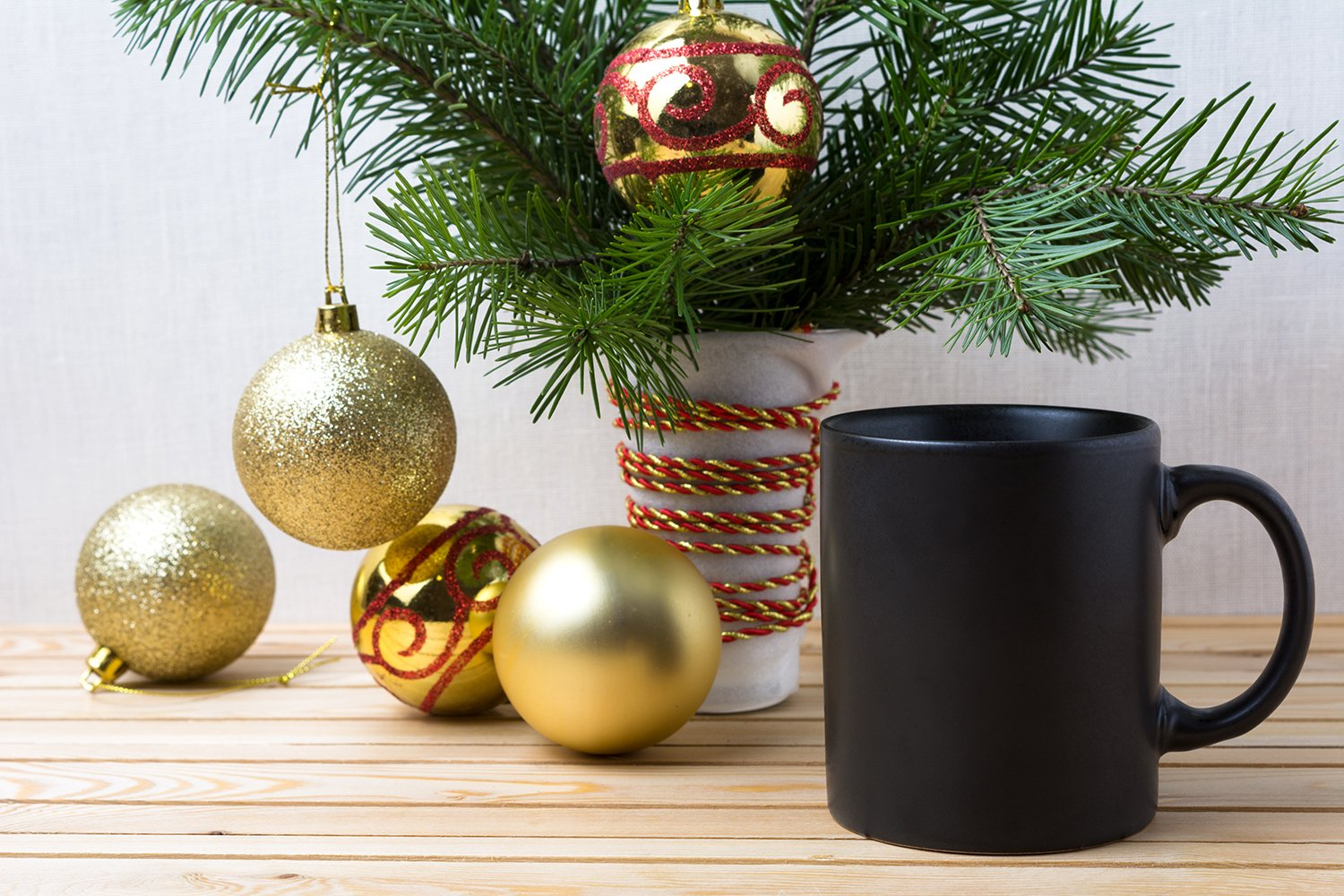Black coffee mug mockup with golden red Christmas ornaments example image 2