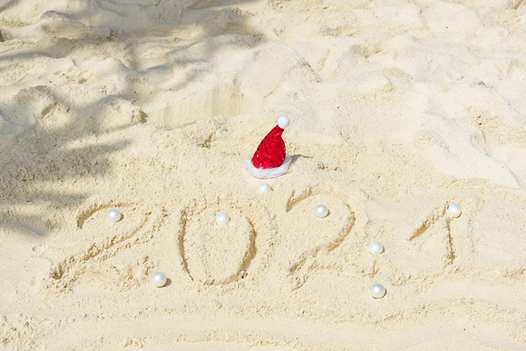 Happy New Year 2021 text in sand example image 1