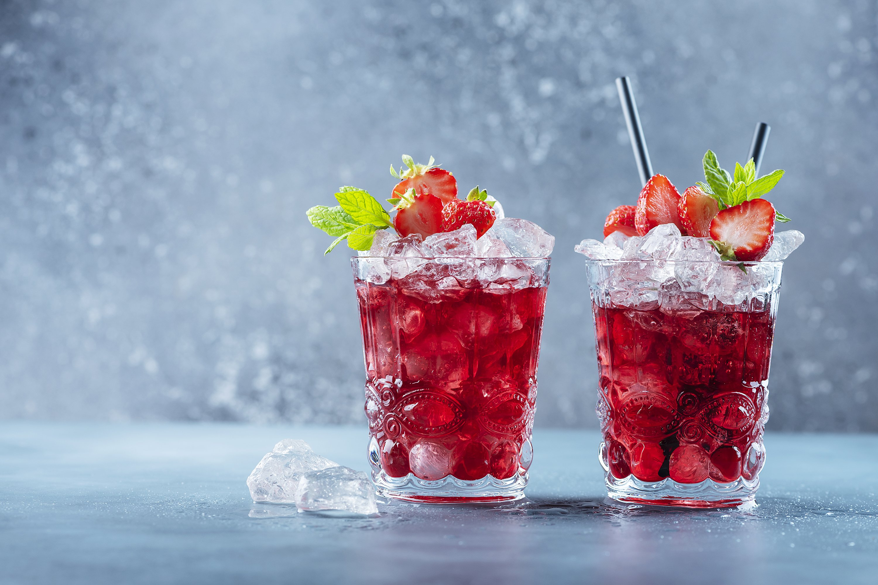 Red cocktail with ice and mint. Bar concept. example image 1