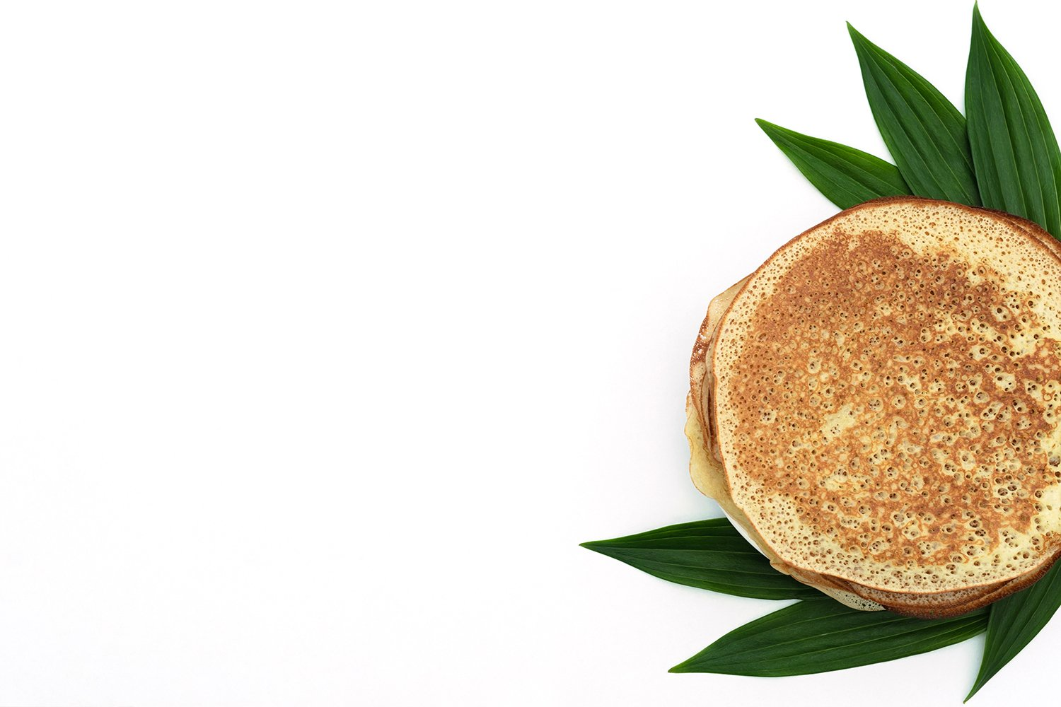 Homemade pancakes on white background with green leaves example image 1