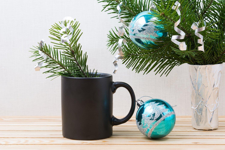 Black coffee mug mockup with blue Christmas ornaments example image 2