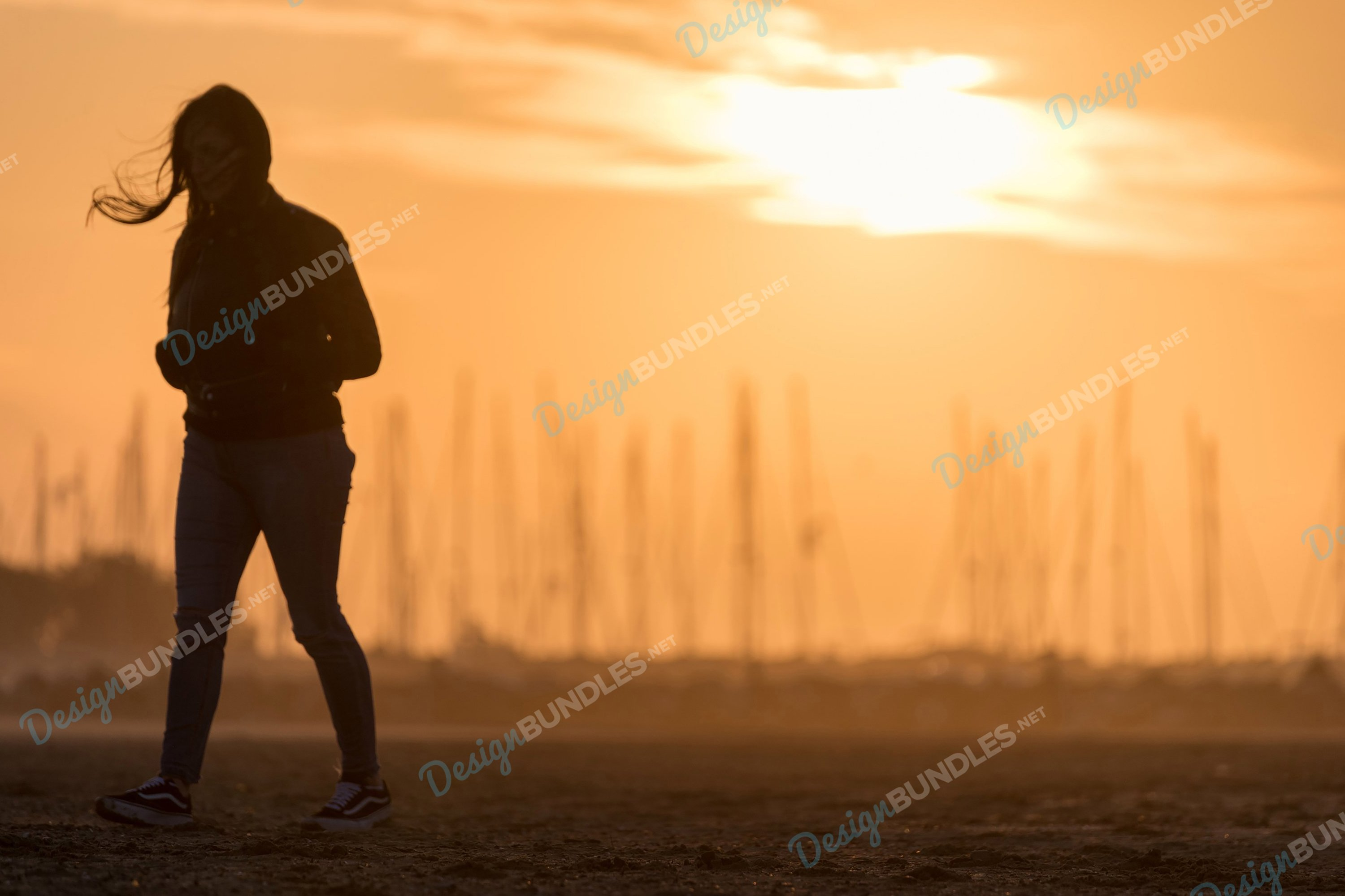 Stock Photo - Young Girl Running at Sunset example image 1