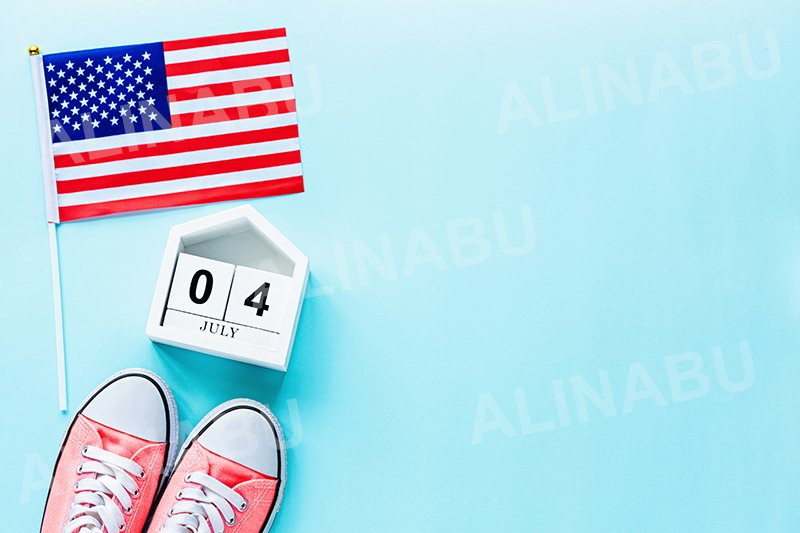 Mockup of july 4 wooden calendar and USA flag on blue example image 1