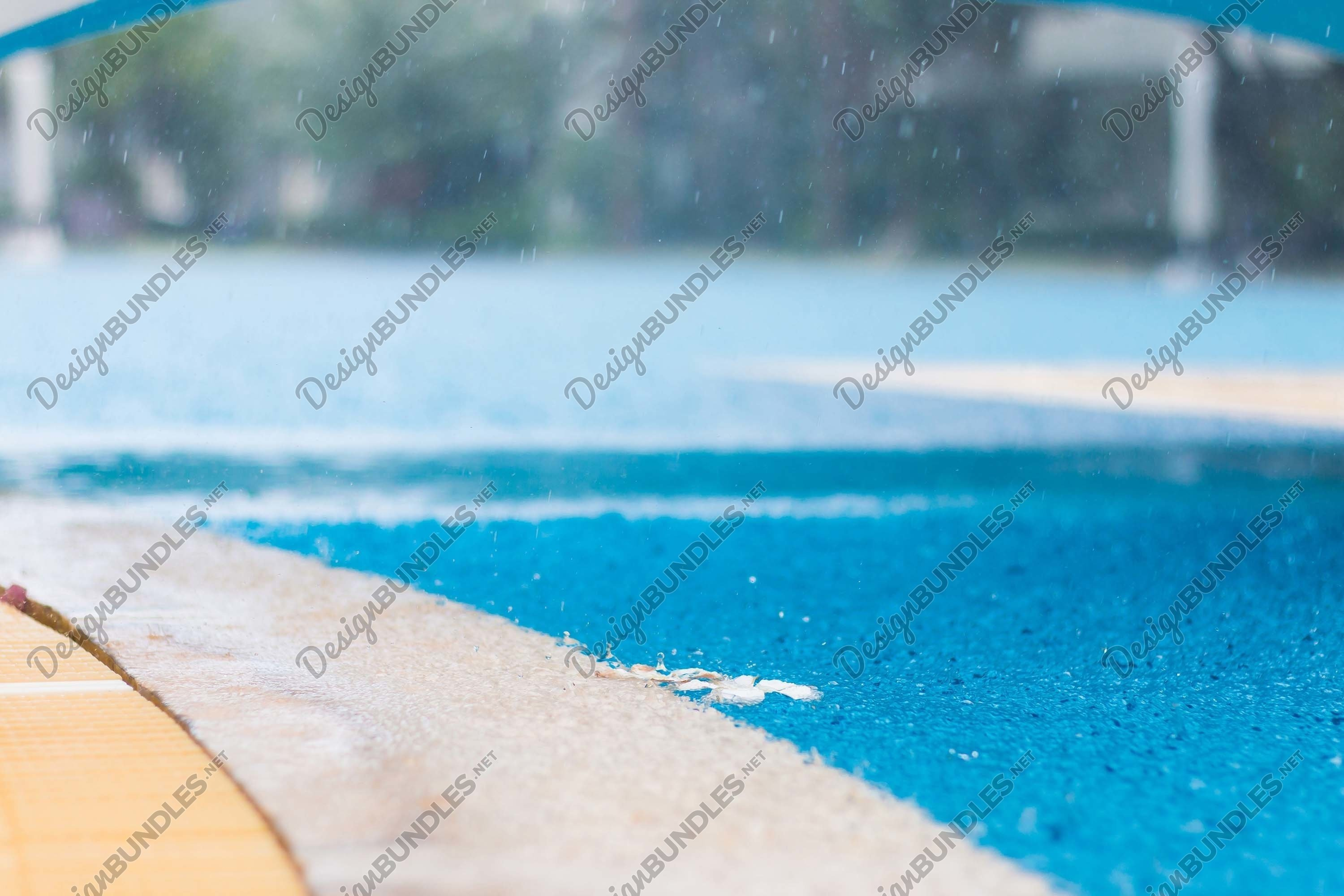 Stock Photo - Rain on the basketball court example image 1