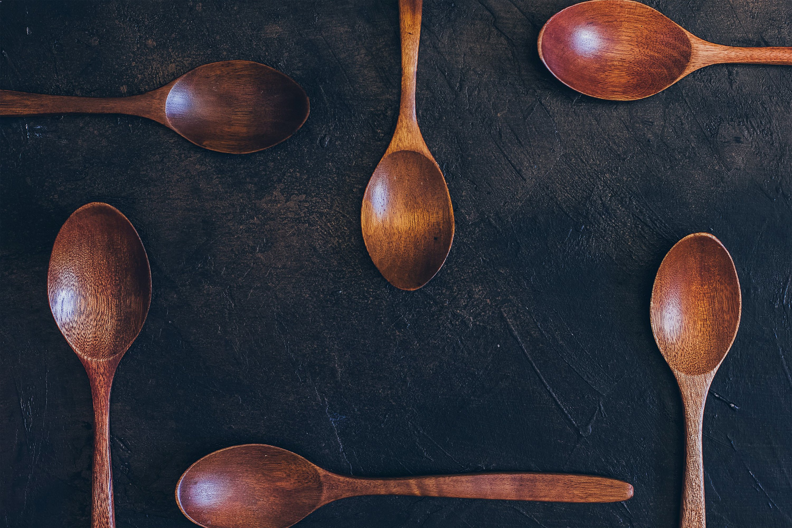 Wooden spoons on old dark example image 1