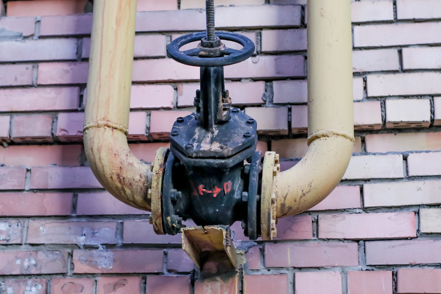gas tap on brick wall background example image 1