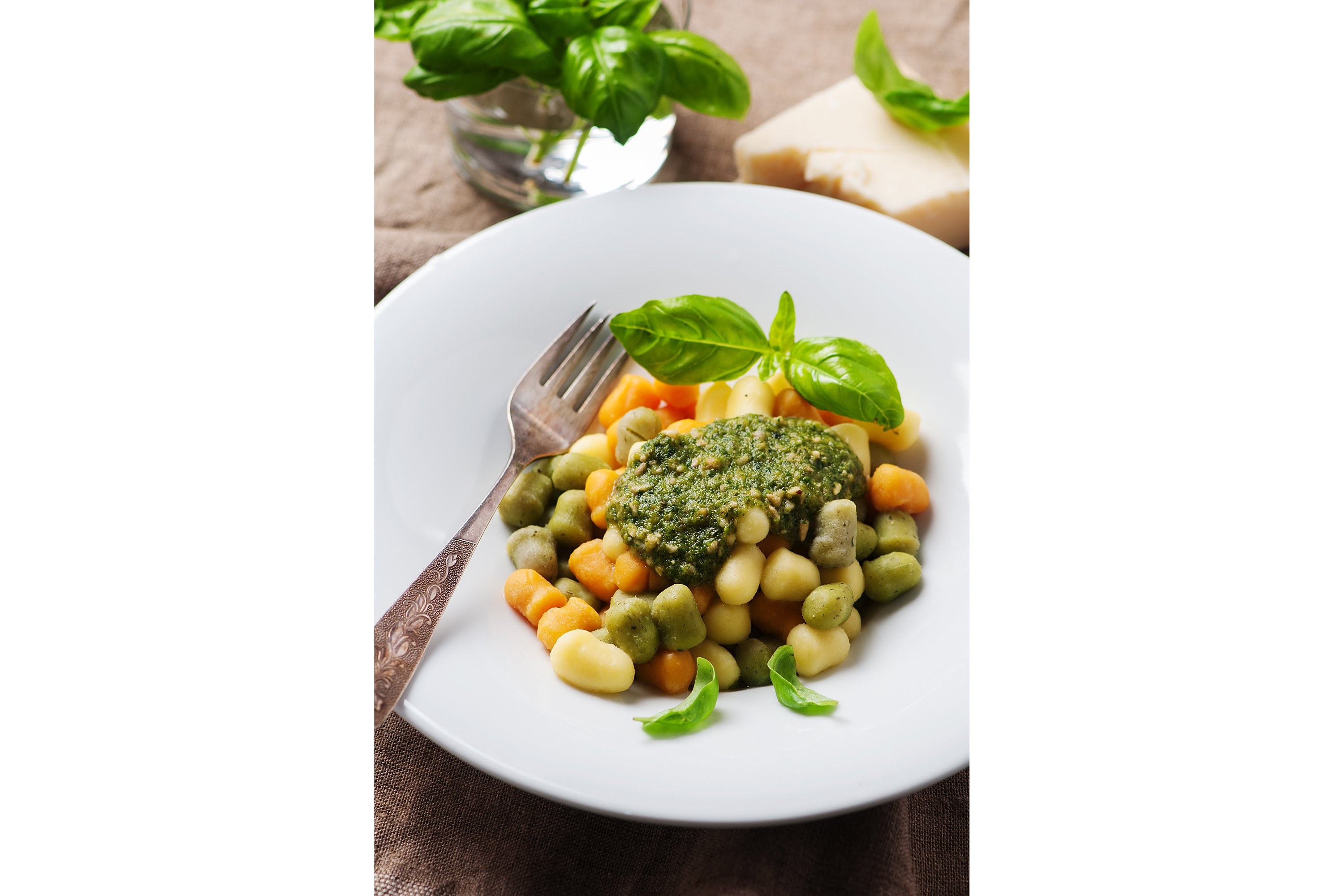 Colored gnocchi with pesto, selective focus example image 1