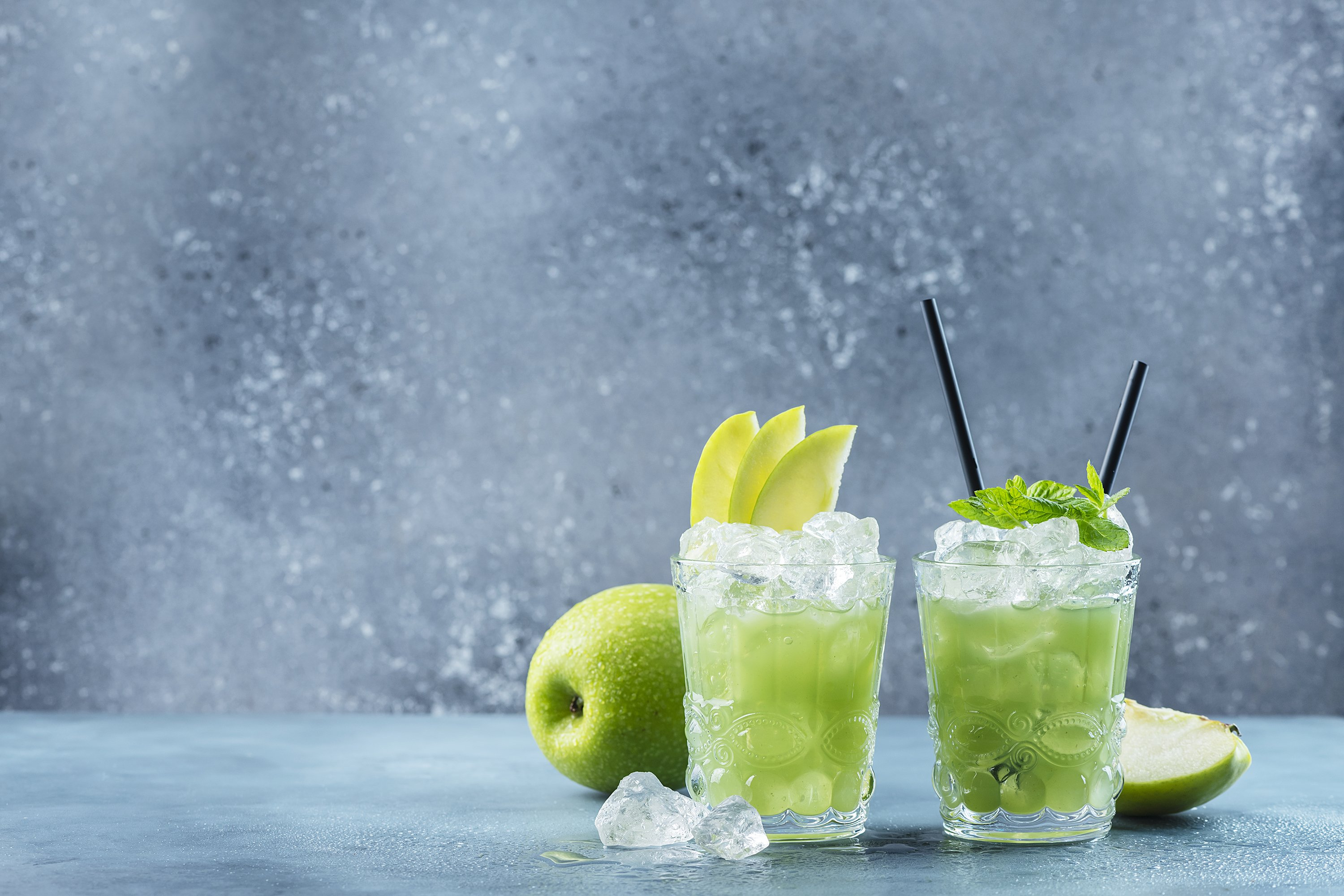 Green cocktail with ice and mint. Bar concept. Apple mojito example image 1