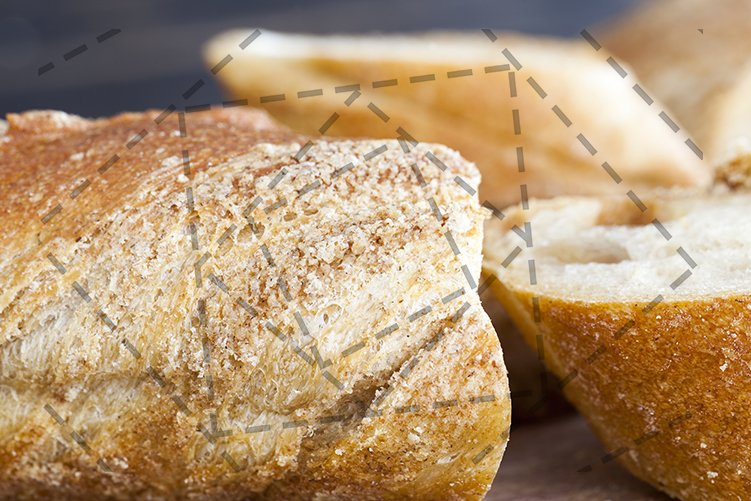 sliced long wheat baguette example image 1