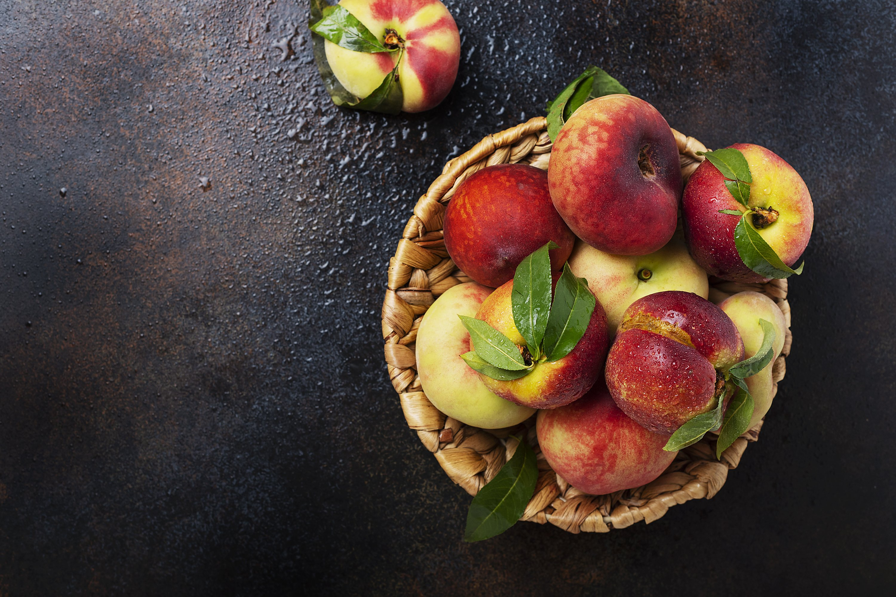 Top down view of sweet peaches with green leaves example image 1
