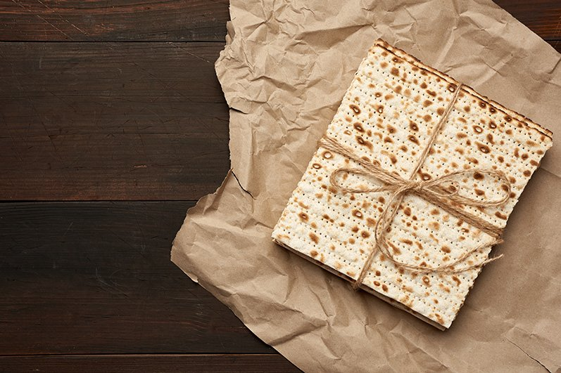 stack of baked square matzo on a white wooden background example image 3