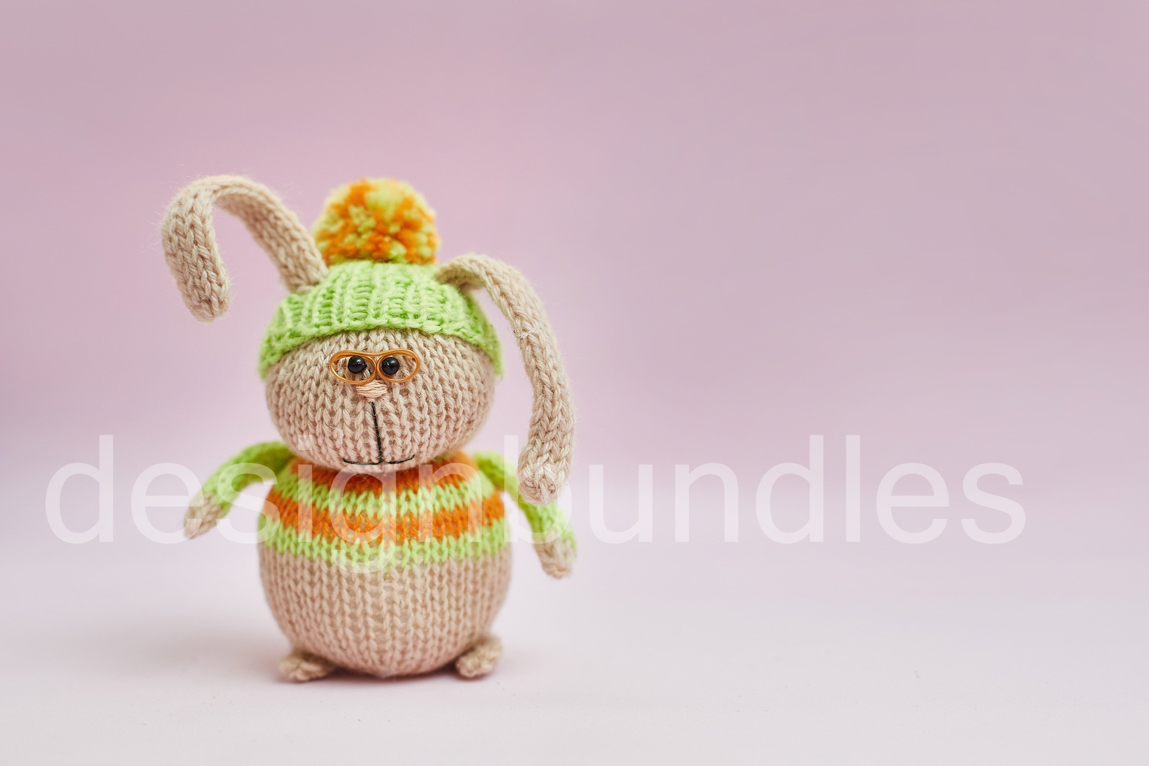 Toy rabbit in glasses on a pink background. example image 1