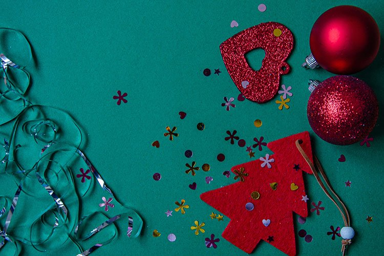 Red Christmas tree, beads, balls on a green background. example image 1