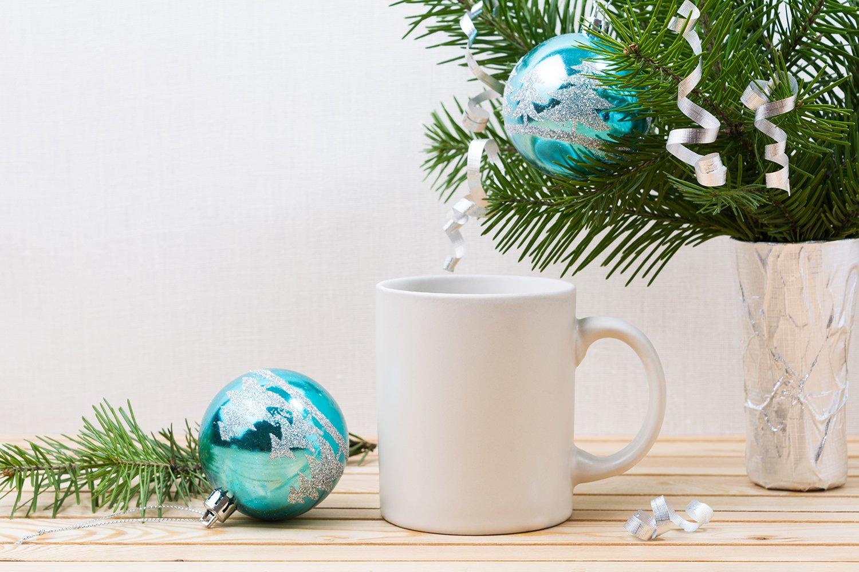 White coffee mug mockup with blue Christmas ornaments example image 2
