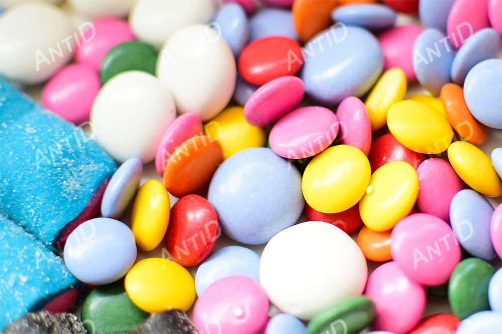 Multicolored candy on a white background. example image 1