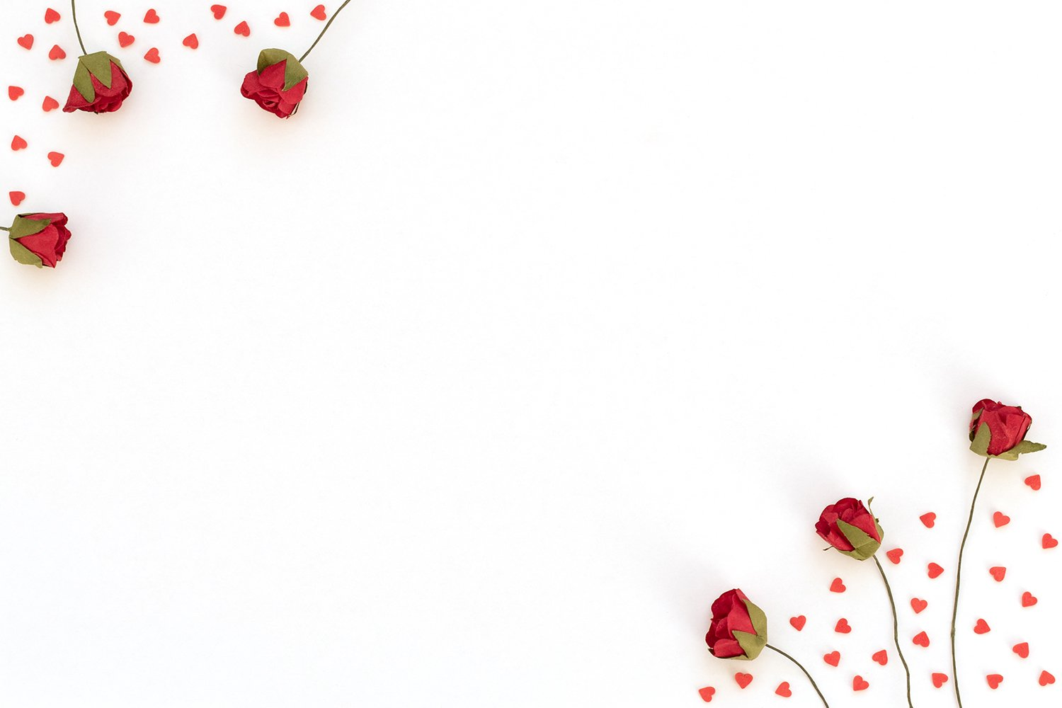 Red roses and a lot of small red hearts on white background. example image 1