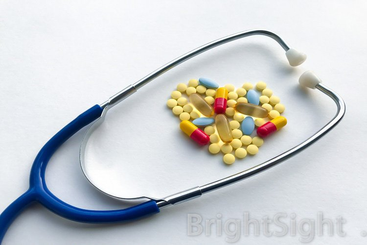Blue stethoscope & heart, lined with pills example image 1