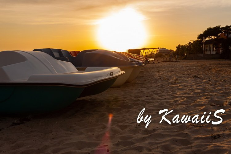 Colorful sunset on empty sea beach with sport catamarans example image 3