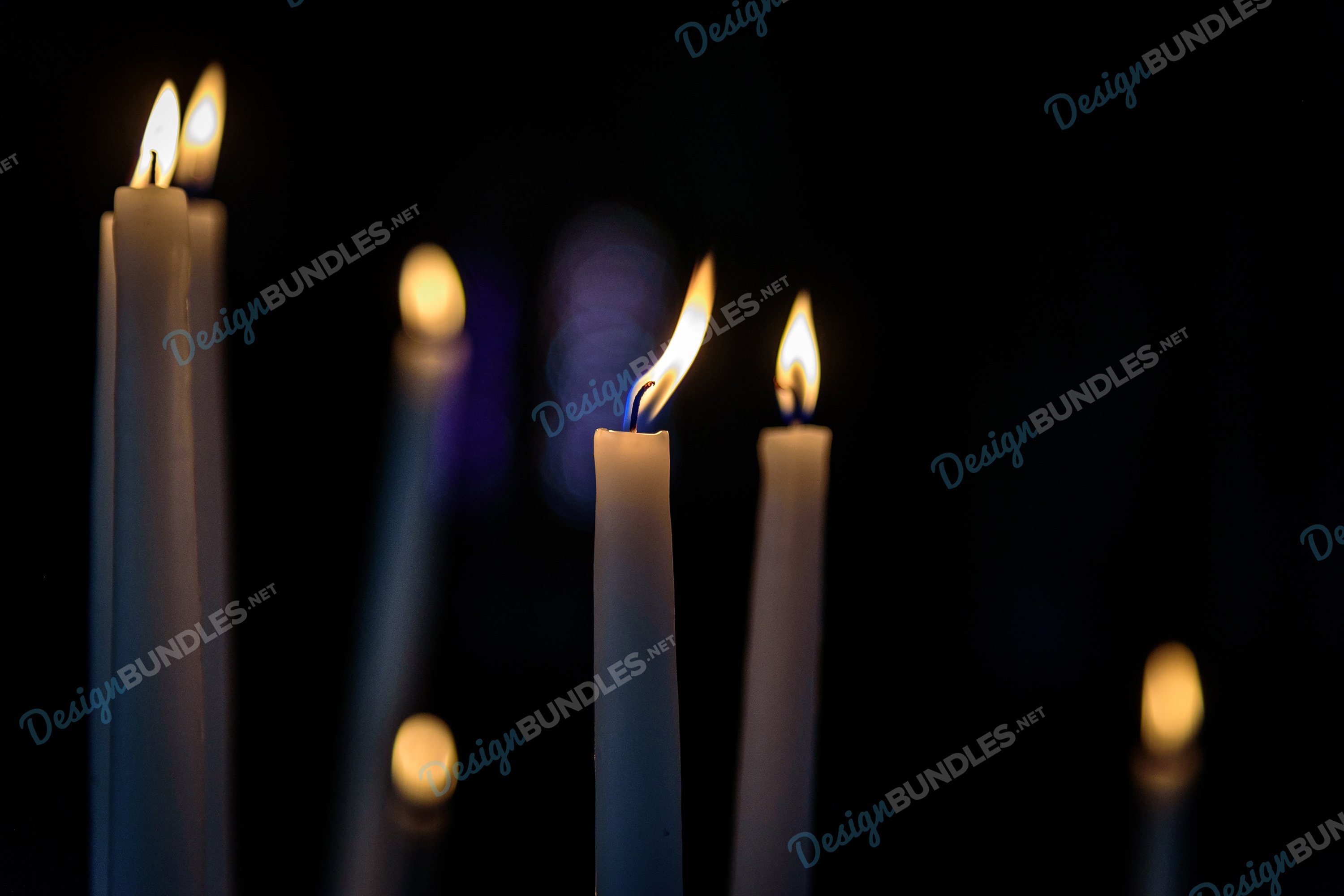 Stock Photo - Close-Up Of Illuminated Candles In Darkroom example image 1