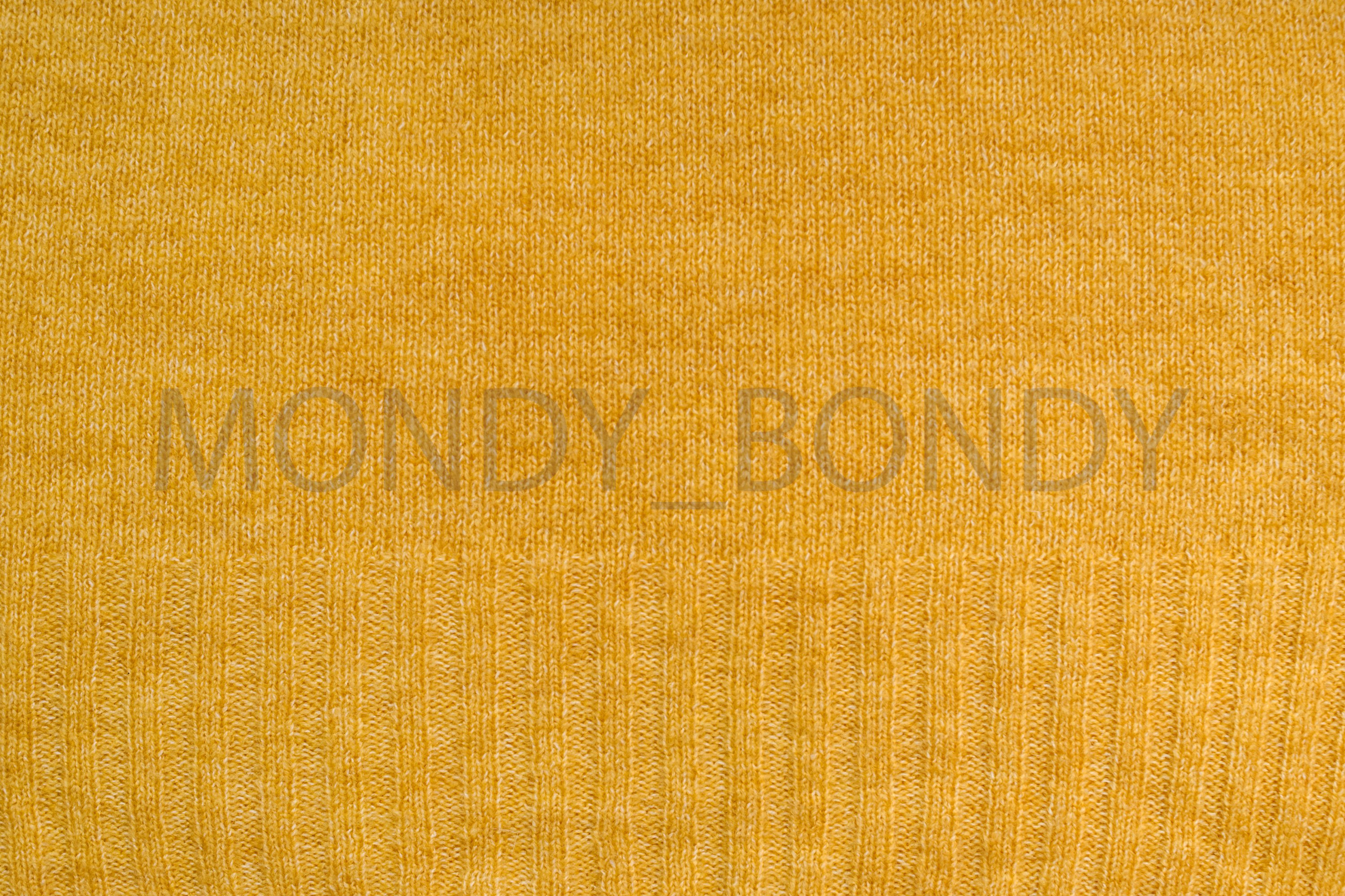 Texture of yellow woolen fabric closeup example image 1