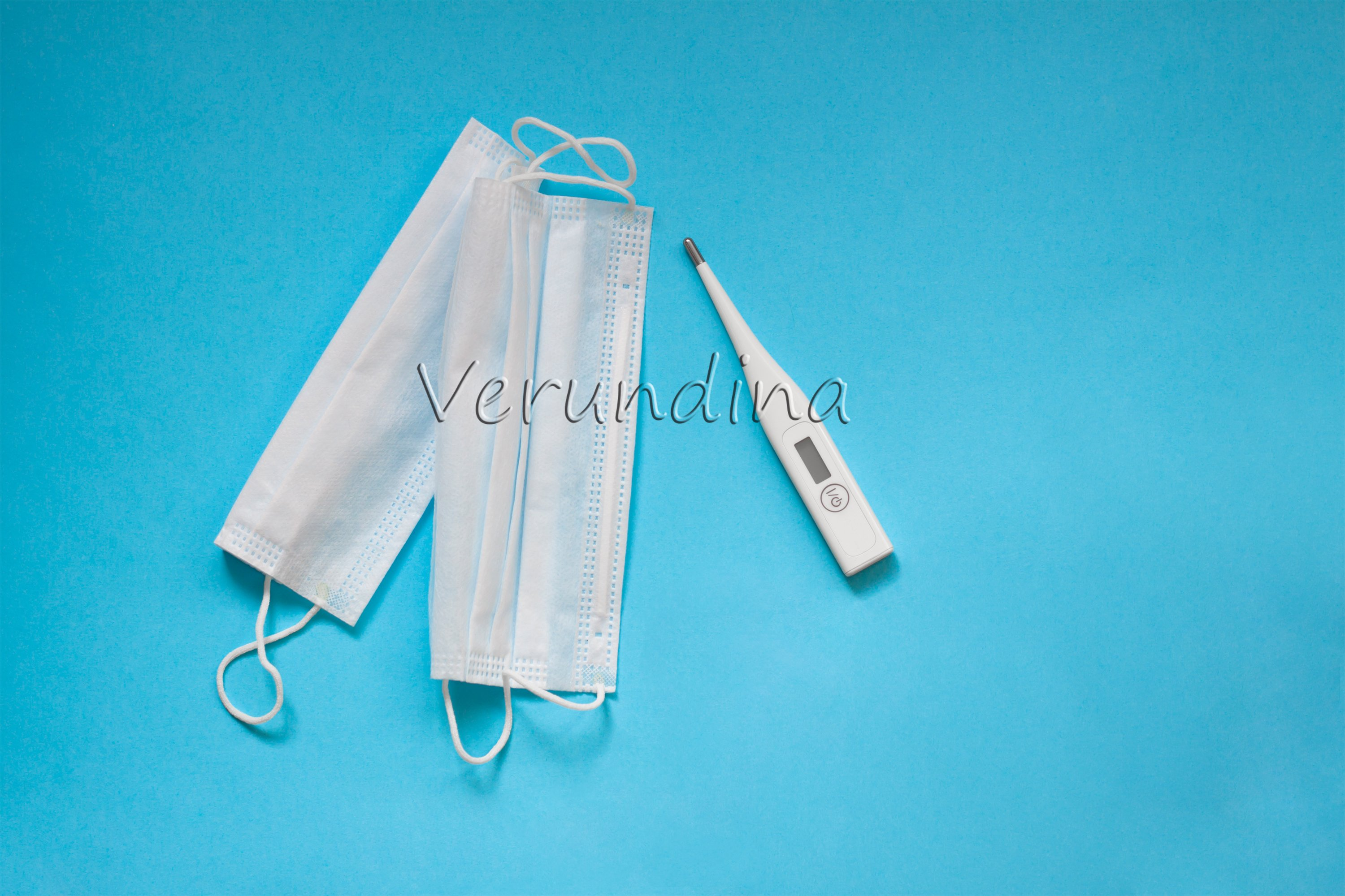 Face masks, thermometer on on a blue background example image 3