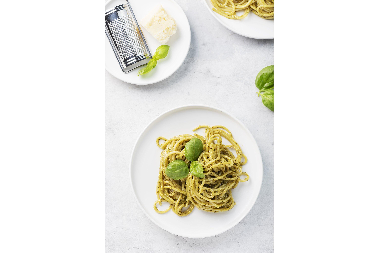 Italian spaghetti with pesto sause and parmesan cheese example image 1