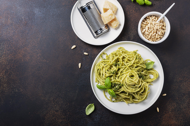 Traditional Italian spaghetti with basil cream pesto. example image 1