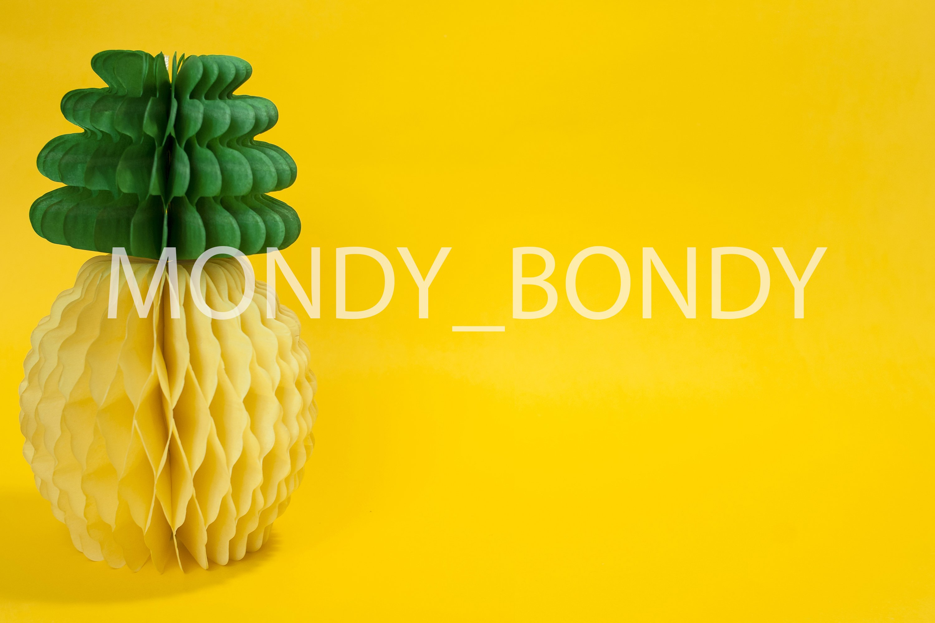 Paper pineapple on a yellow background example image 1
